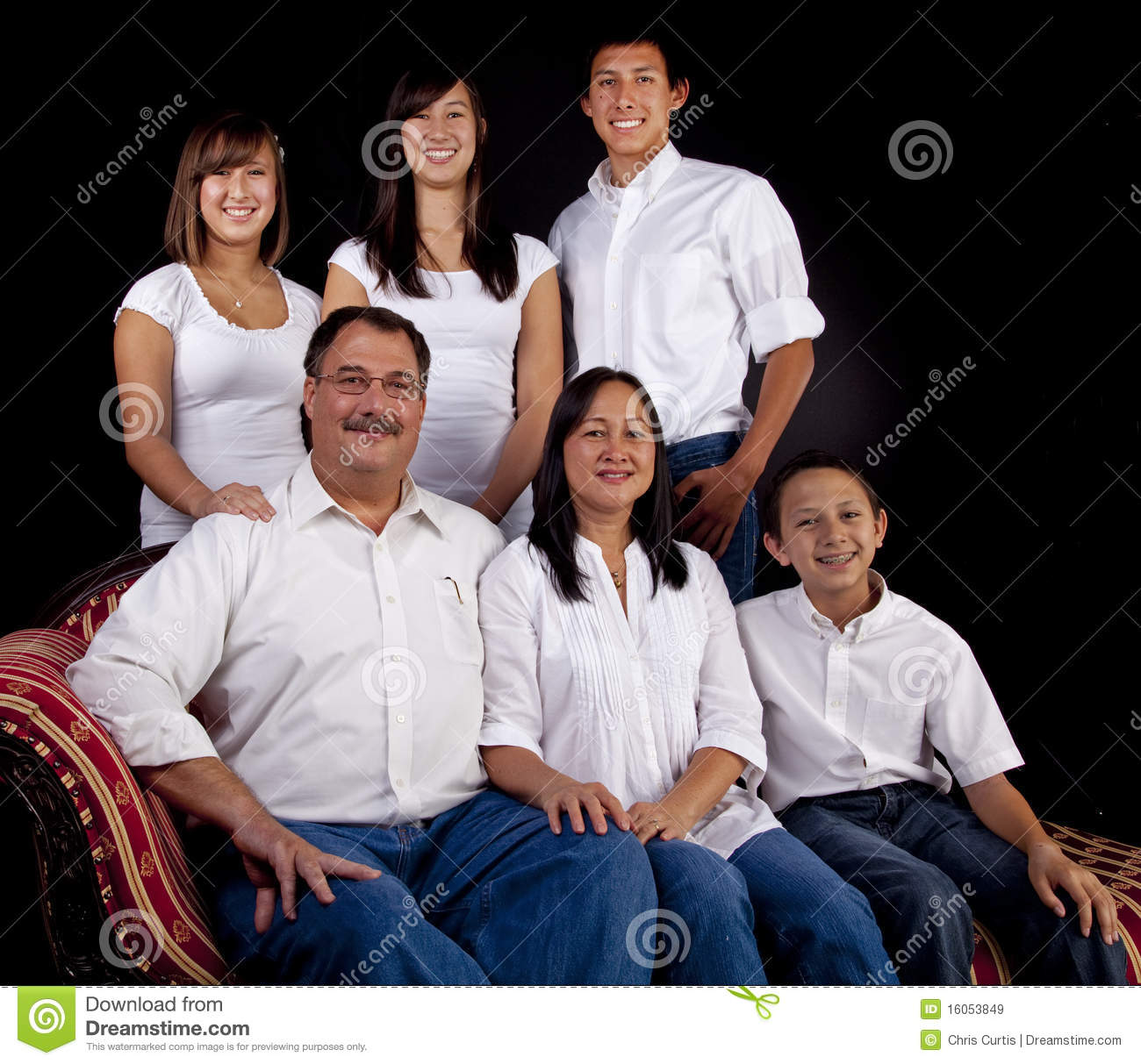 Family Portrait On Seated With Black Background Stock
