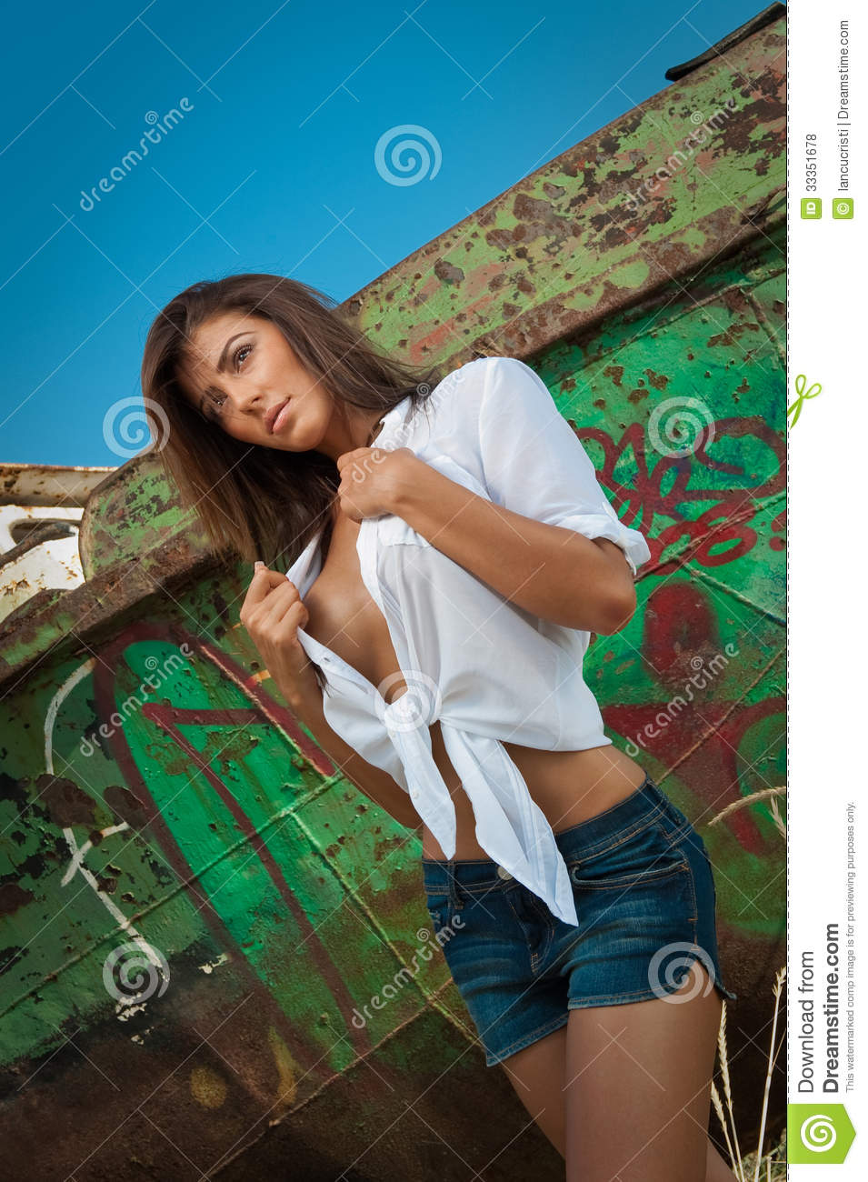 Fashion Caucasian Model Posing Outdoor In Front Of An Old