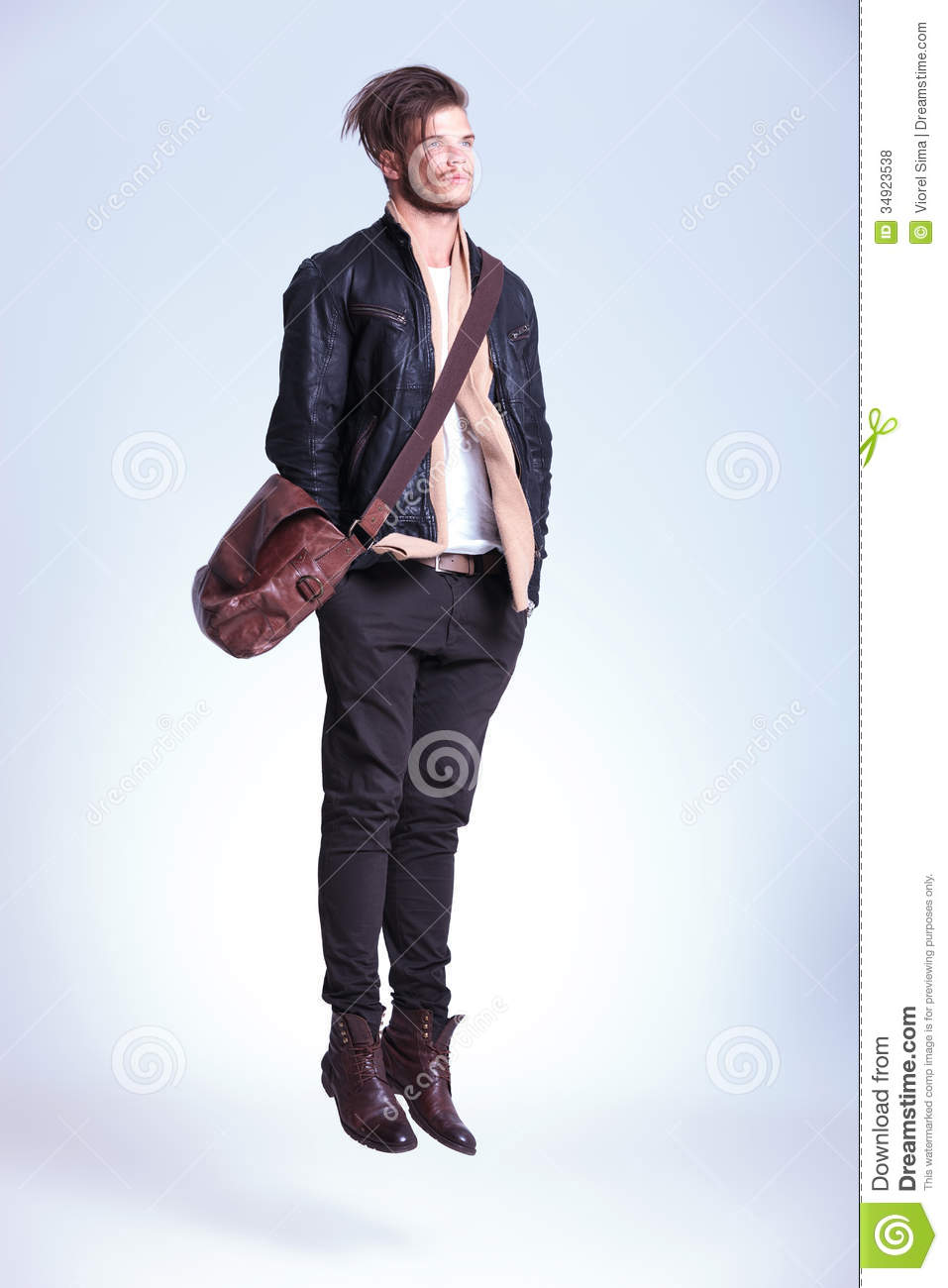 Fashion Man With Hands In Pockets Is Jumping Stock Photo
