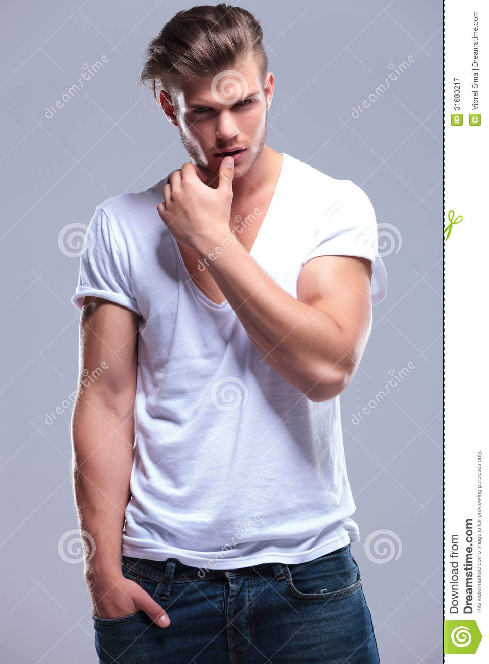 Fashion Man With Thumb On Lower Lip Stock Image Image