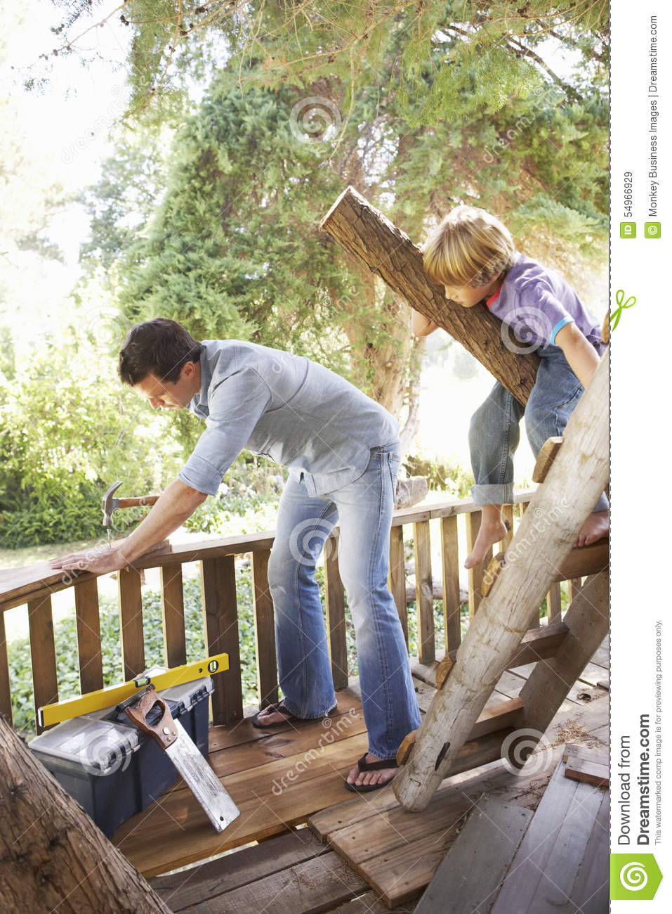 Father And Son Building Tree House Together Stock Image