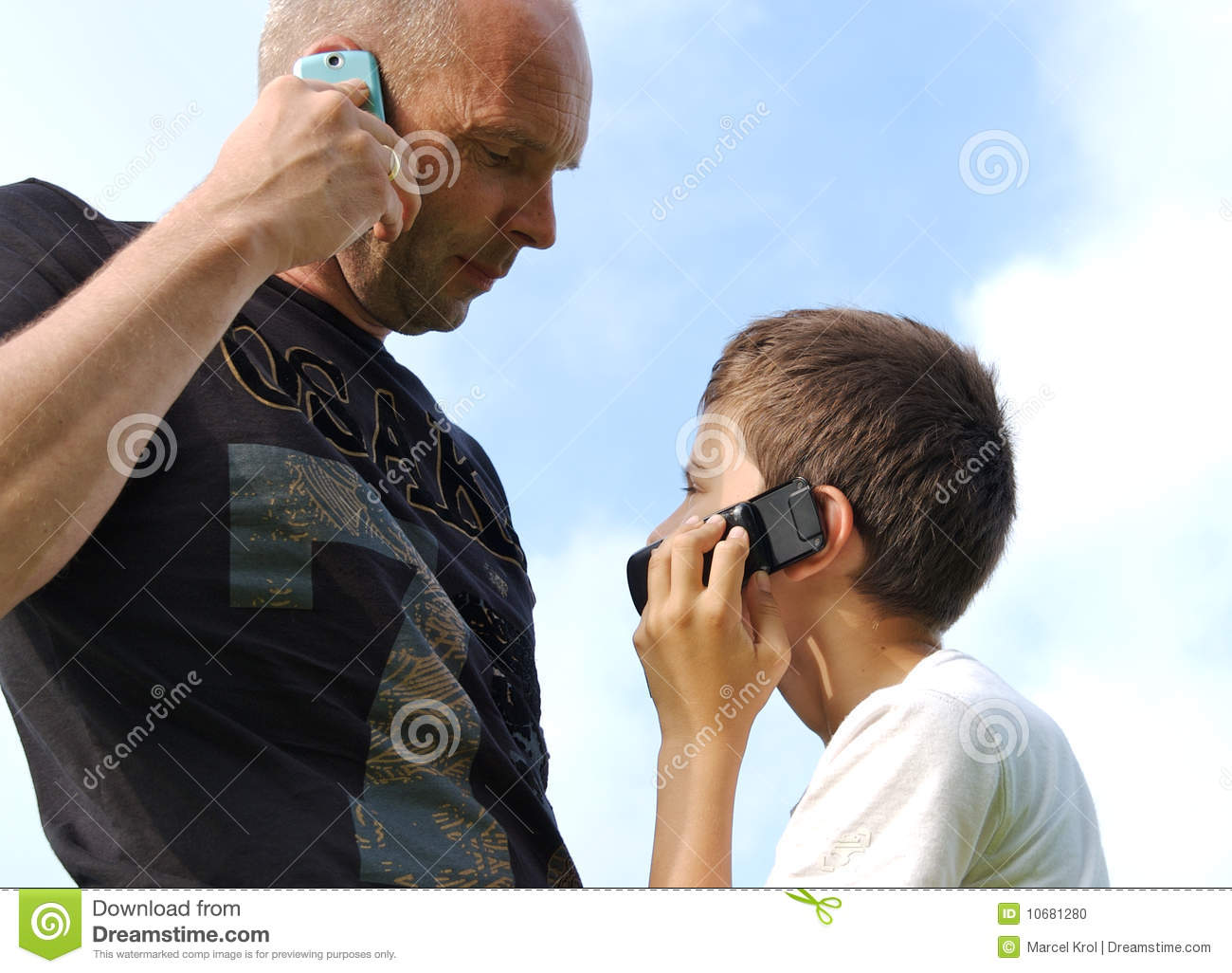 Father And Son Calling Eachother Stock Photo
