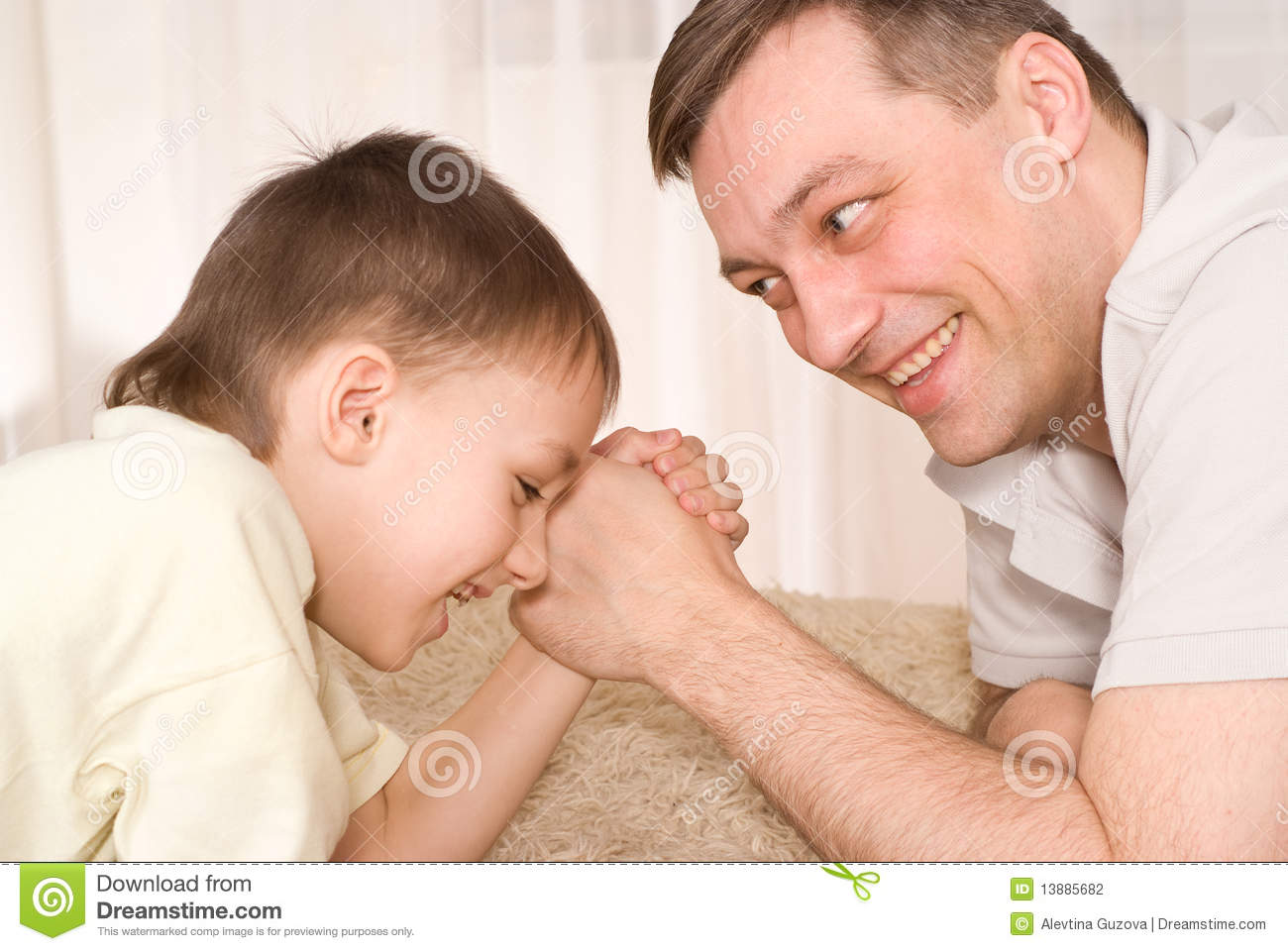 Father And Son Fight On His Hands Stock Photo