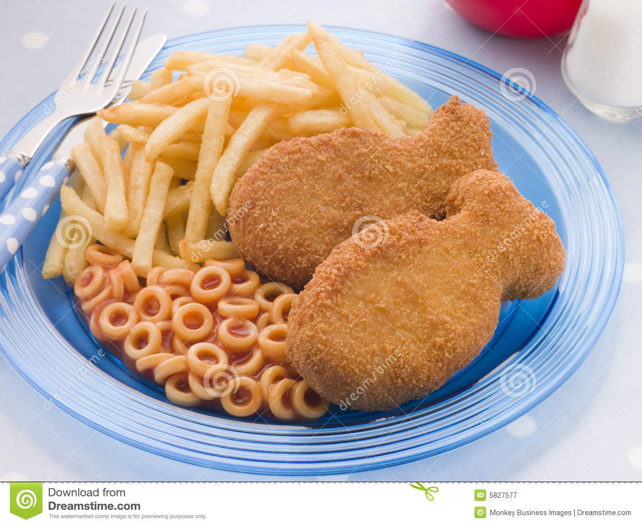 Fish Cakes With Spaghetti Hoops And Chips Stock Image