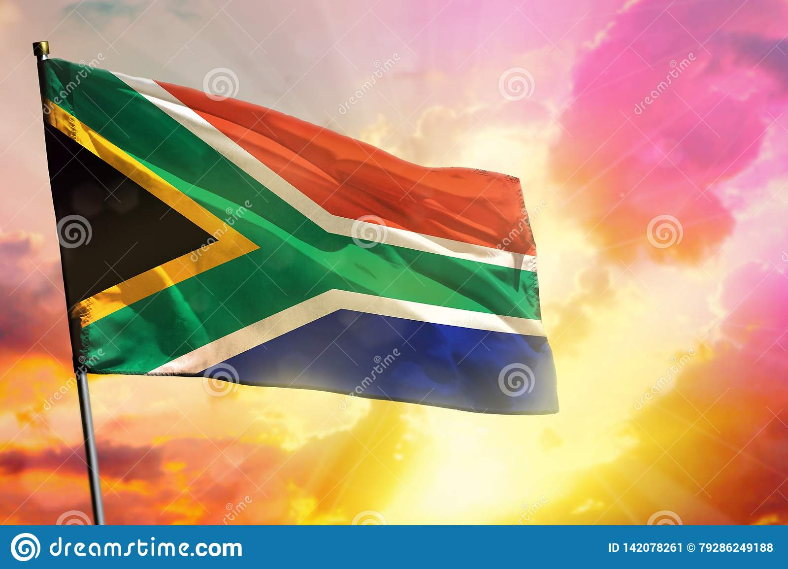 Fluttering South Africa Flag On Beautiful Colorful Sunset