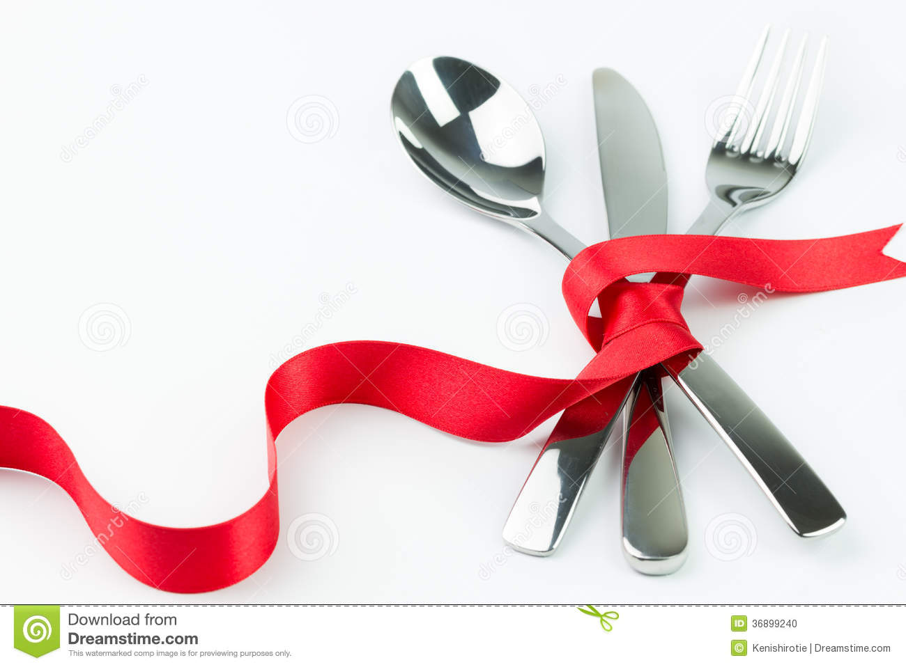 Fork Spoon And Knife Tied Up With Red Ribbon Stock Photo