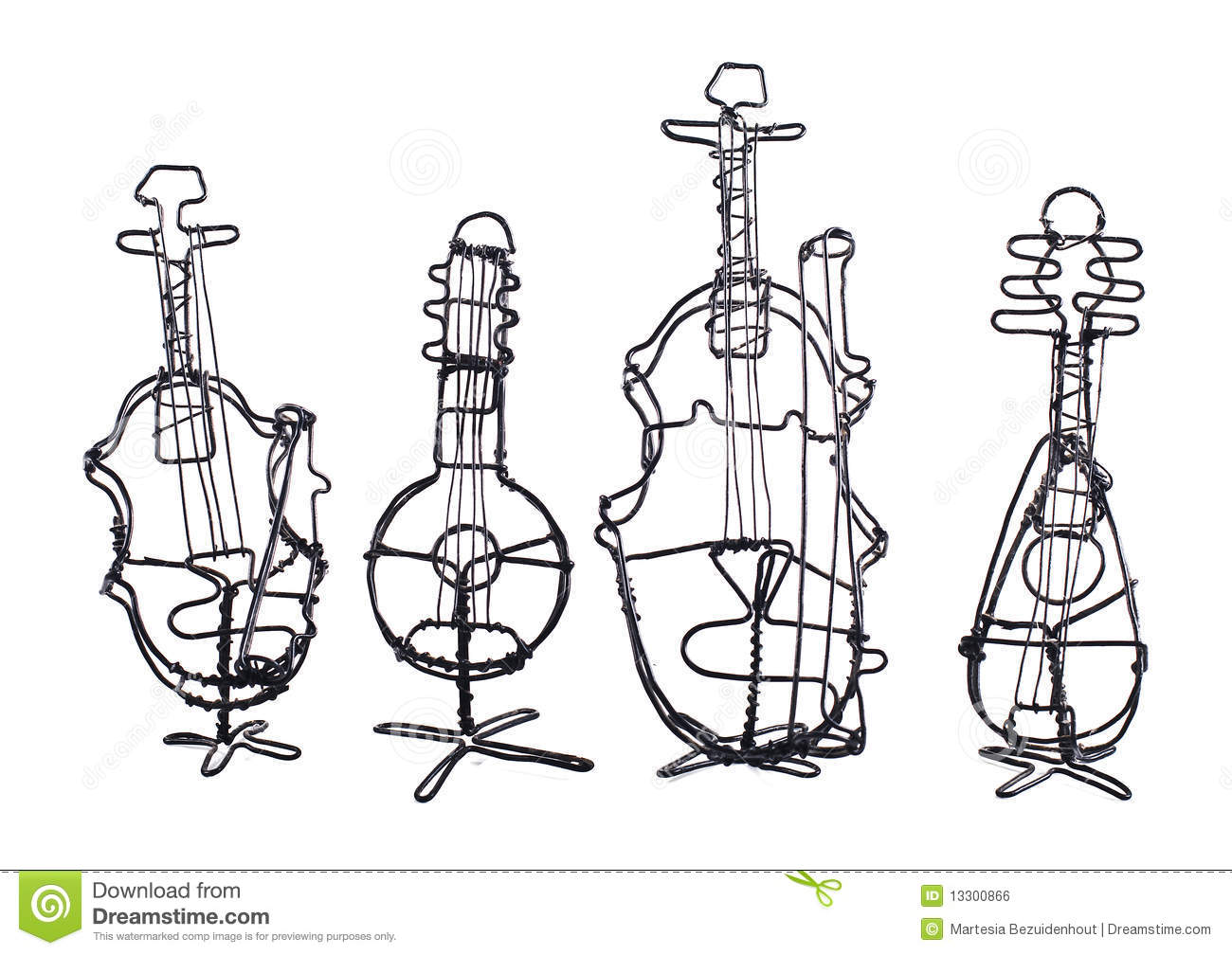 Four String Instruments Made Of Wire On A White Royalty