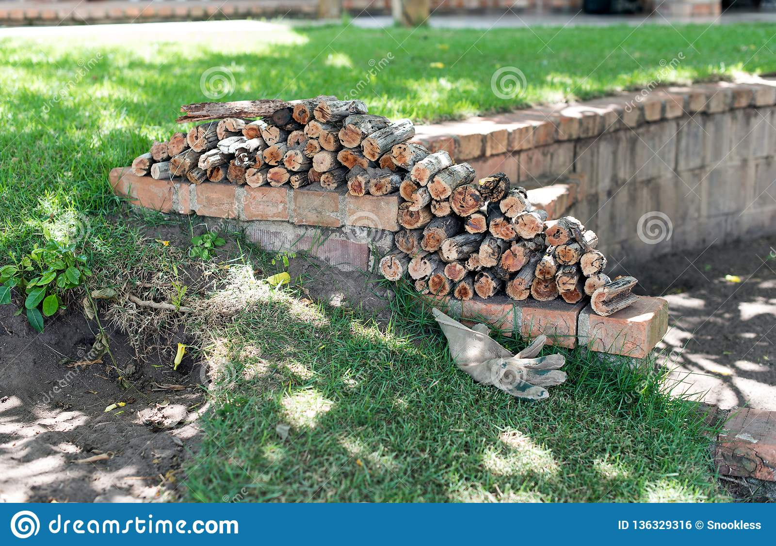 https www dreamstime com fresh cut firewood logs stacked outdoor patio wall sunny green garden firewood wall image136329316
