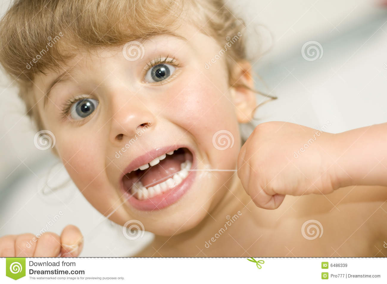 Girl Cleaning Teeth By Dental Floss Stock Image Image Of