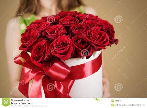 Girl Holding In Hand Rich Gift Bouquet Of 21 Red Roses