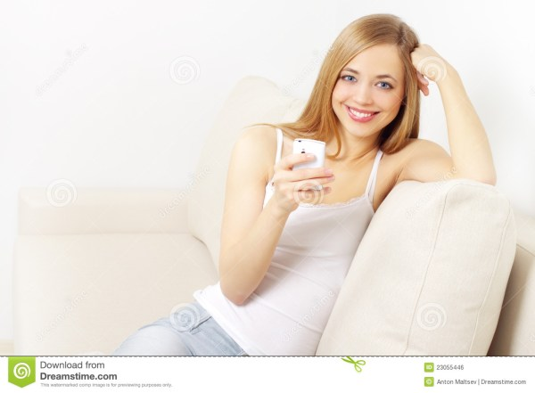 Girl Holding A Mobile Phone Royalty Free Stock Image