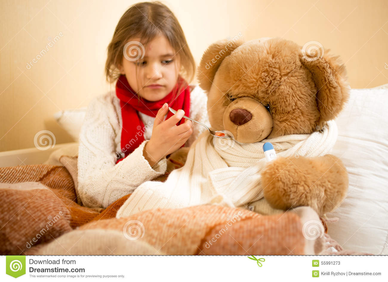 Girl Playing And Measuring Teddy S Bear Temperature With