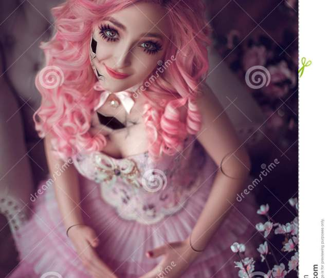Photo Session Of The Girl Porcelain Doll Girl With Pink Hair Looking In The Mirror And Sees His Reflection Baby Doll Fashion Creative Color Toning