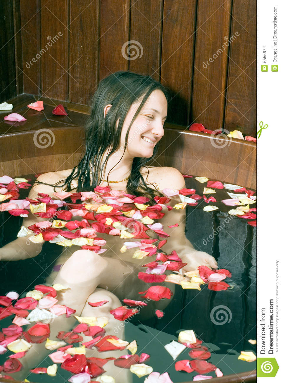 Girl Smiling In Bathtub Vertical Stock Photography