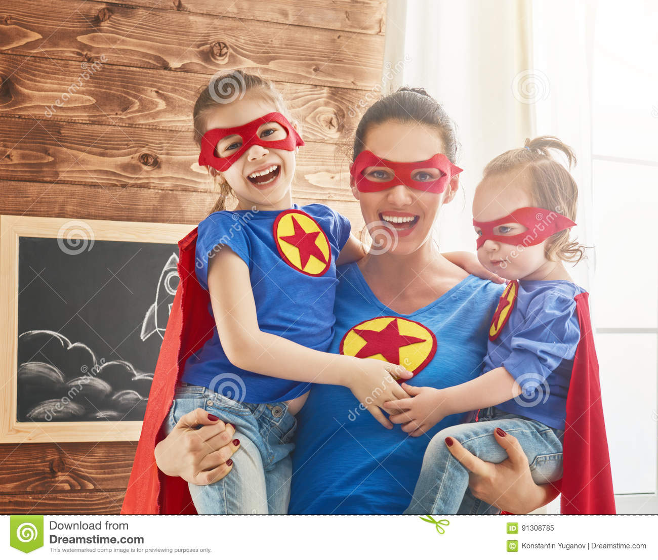 Girls And Mom In Superhero Costumes Stock Image