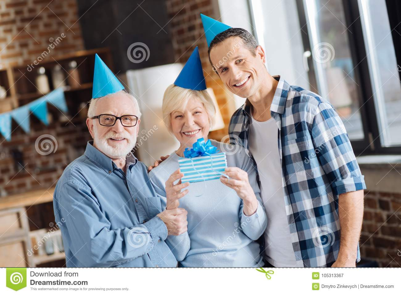 Upbeat Father And Son Posing With Mother Celebrating