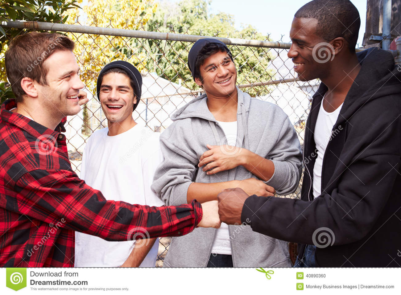 Group Of Young Men Greeting One Another In Urban S Stock