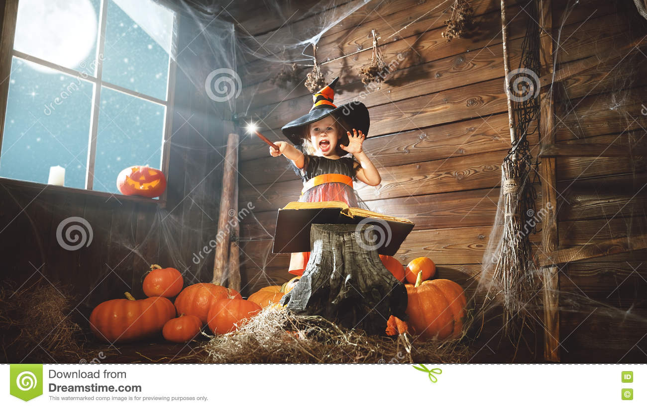 Halloween Child Little Witch With Magic Wand And Reading