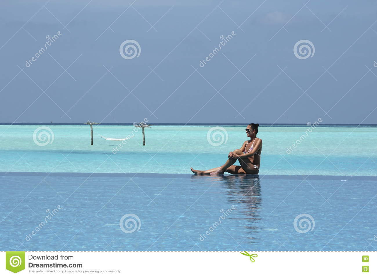 Hammock In Water And Girl In Maldives And Infinity Pool