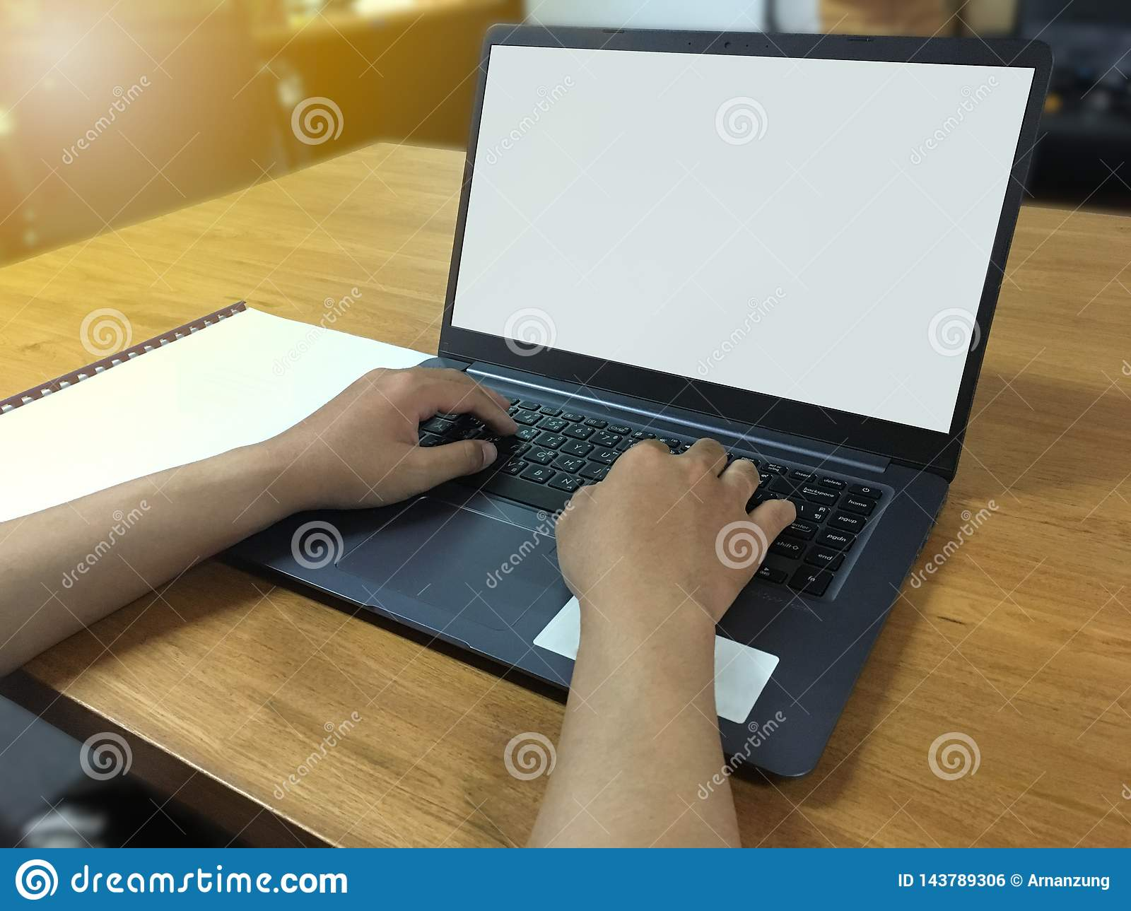 Hand Typing On Keyboard With Blank Screen Of Laptop And