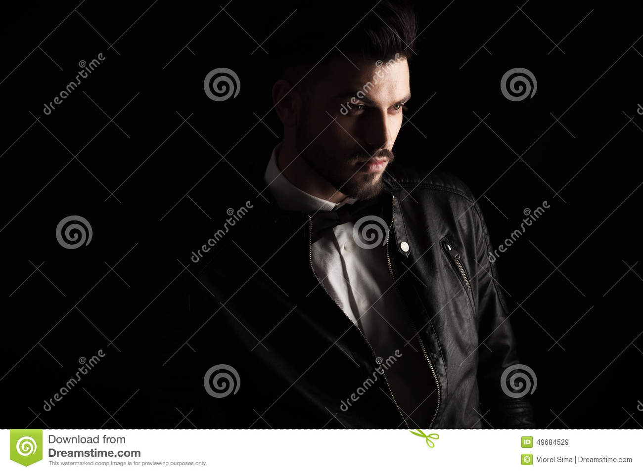 Handsome Business Man Looking Away From The Camera Stock