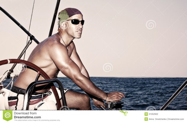 Handsome man on sail boat stock photo. Image of male ...