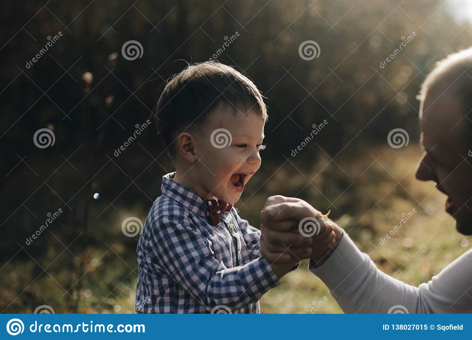 Handsome Young Father Son Competing In Arm Wrestling With