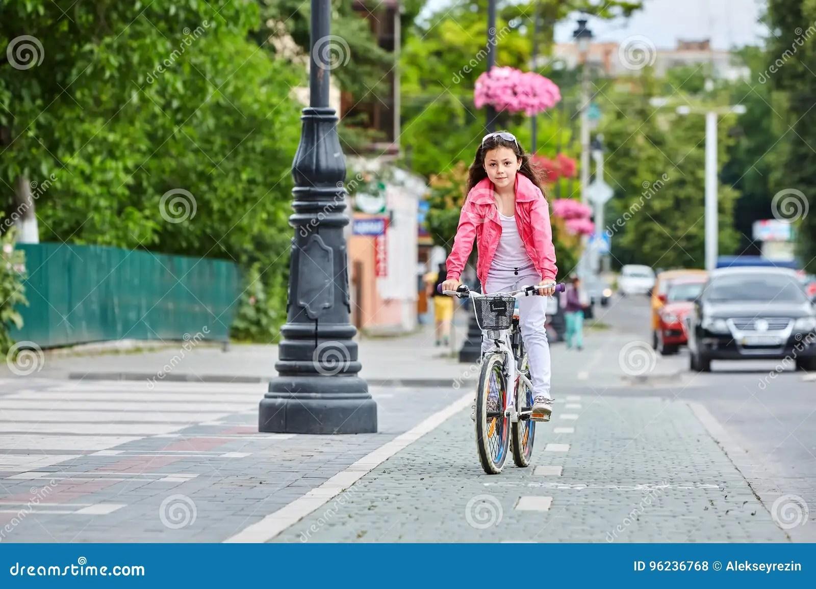Cute Kid In Safety Helmet Biking Outdoors Little Girl On