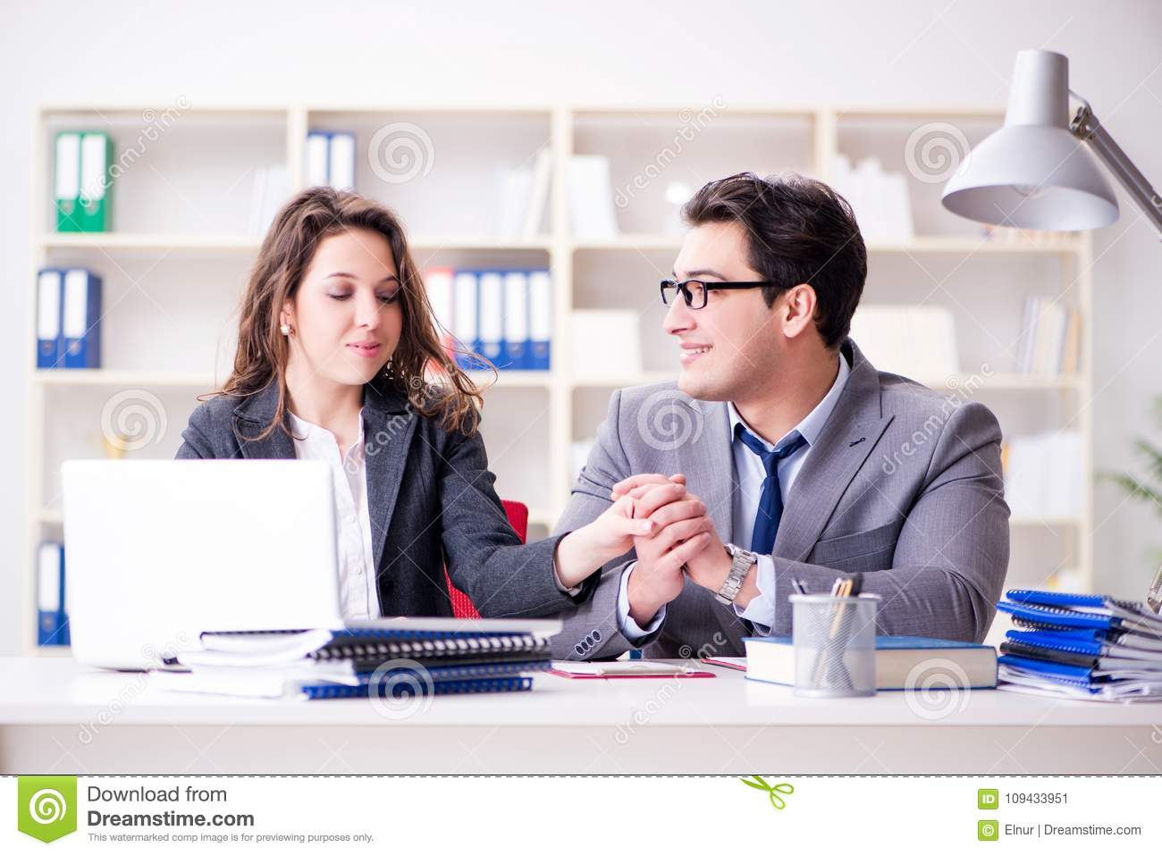 The Happy Couple Working In The Same Office Stock Image
