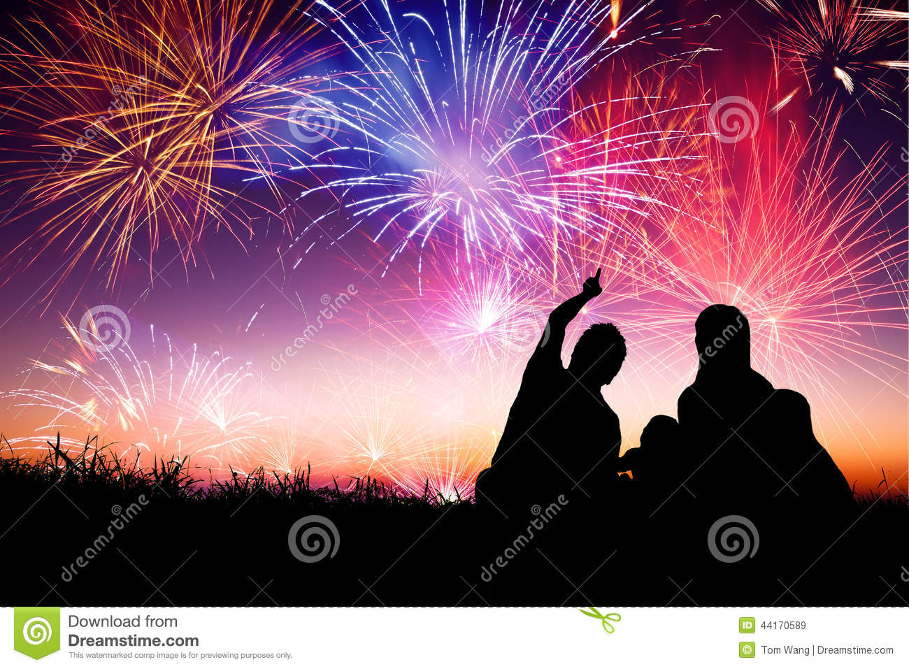 happy family sitting on floor and watching the fireworks stock
