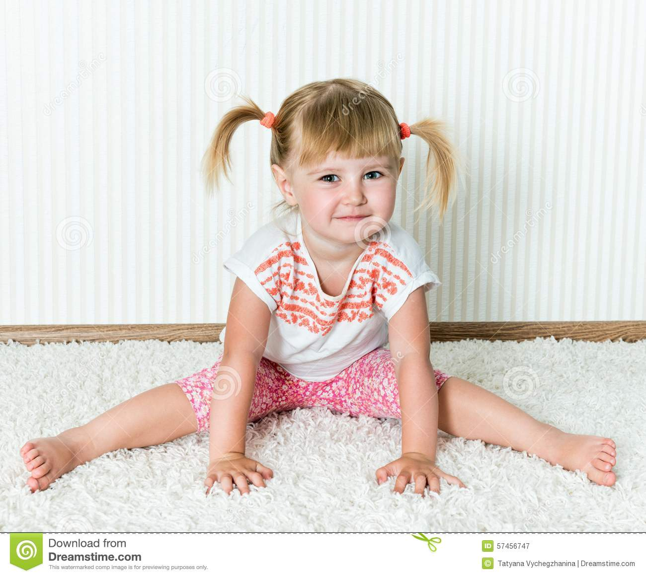 Happy Little Girl Engaged In Physical Activity Stock Image