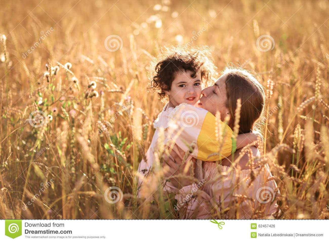 Happy Mother Communication With Daughter In A Wheat Field