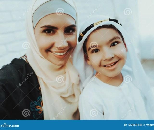 Happy Muslim Mom With Little Son Making Selfie