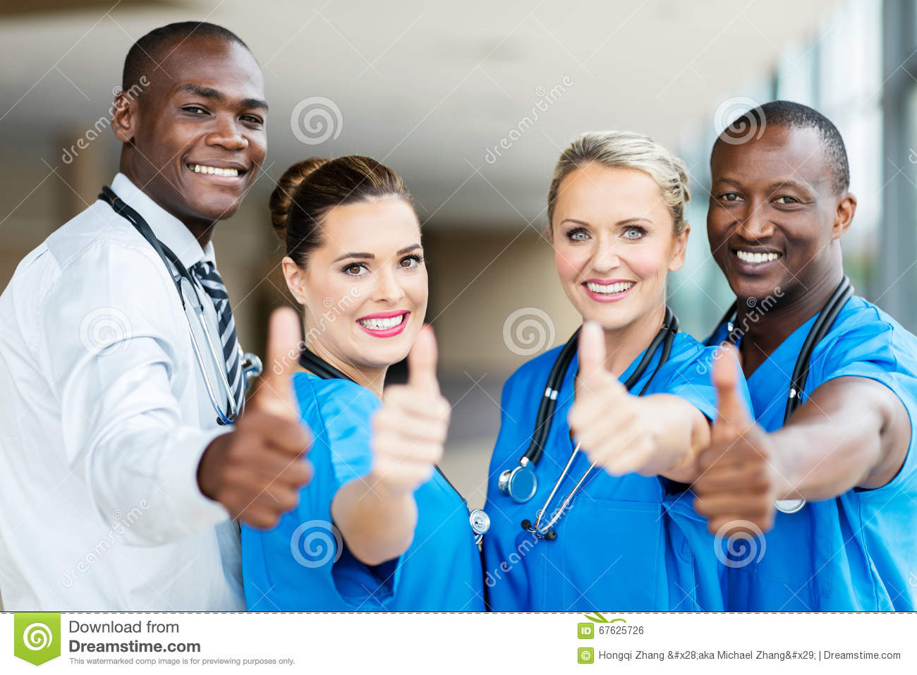 Healthcare Workers Thumbs Up Stock Photo