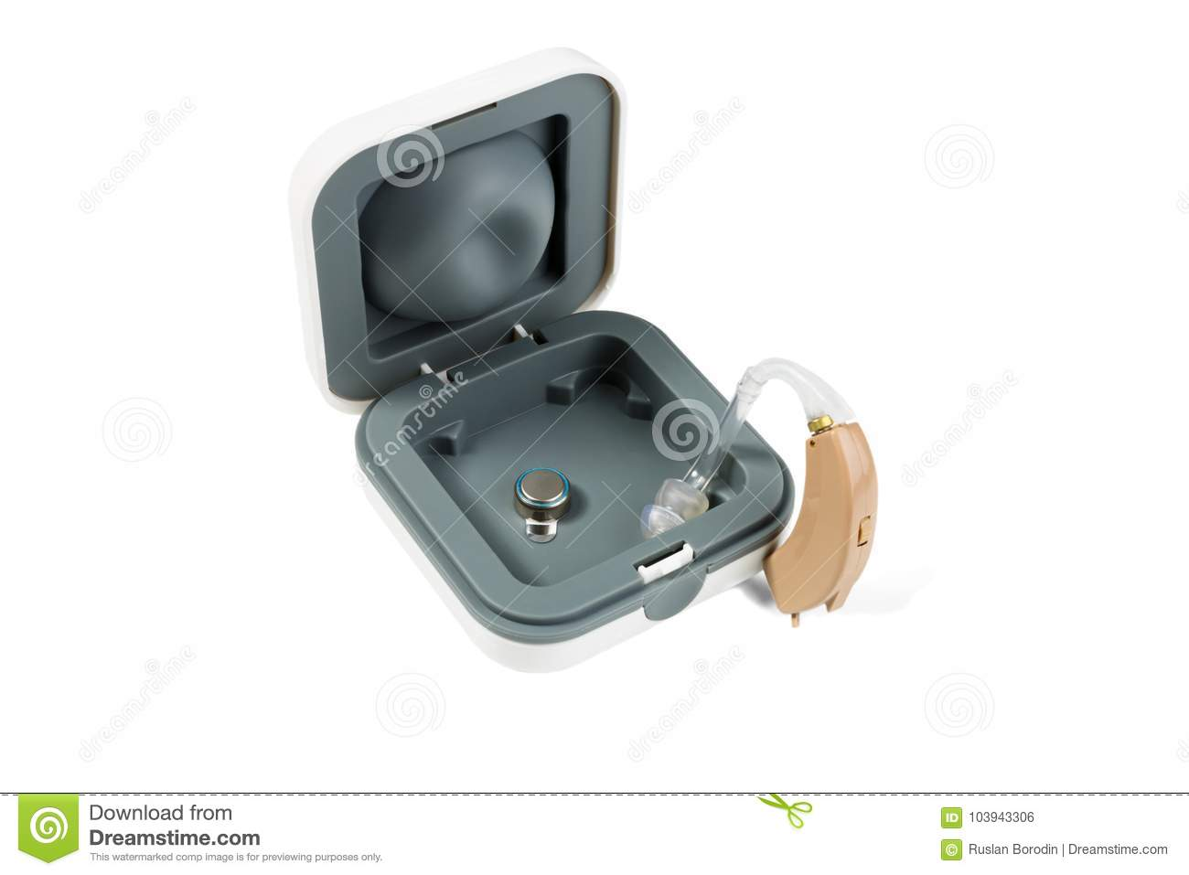 Hearing Aid Part In A Box And Part Outside On A White