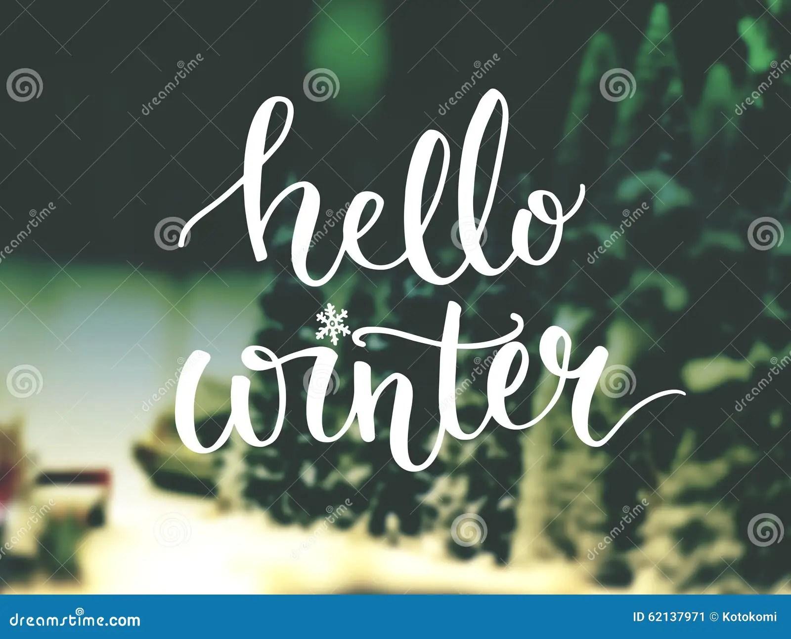 Hello Winter Typography Overlay On Blurred Photo Stock