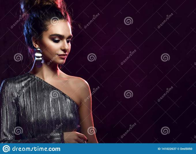 high fashion. gorgeous disco party girl with neon glowing