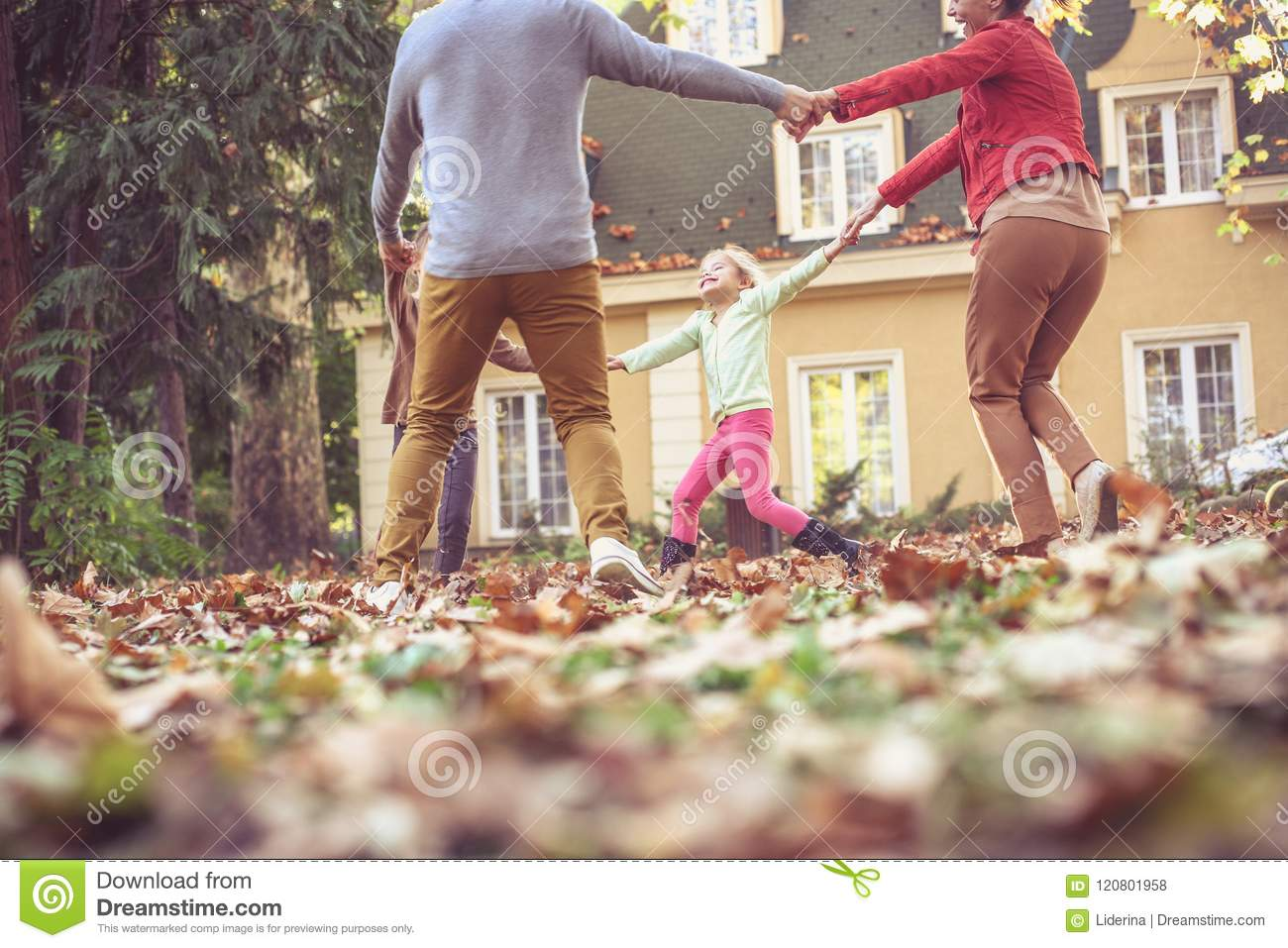 Holding Hands And Spinning Around Have Fun Family Stock Photo