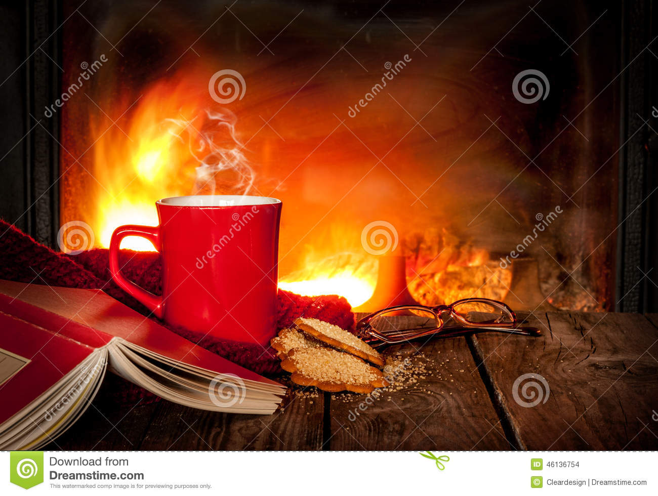 Hot Tea Or Coffee In A Red Mug Book And Fireplace Stock