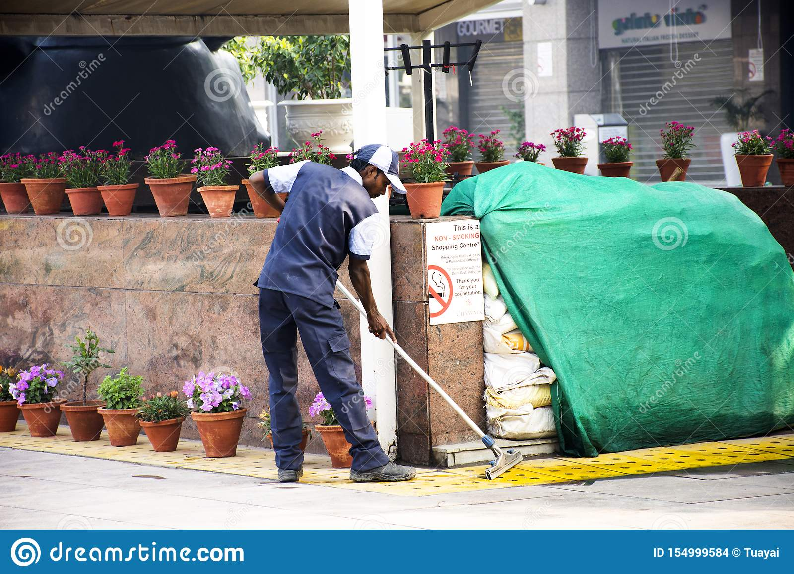 https www dreamstime com indian men worker cleaner cleaning floor patio park garden department store delhi city morning start thai festival image154999584