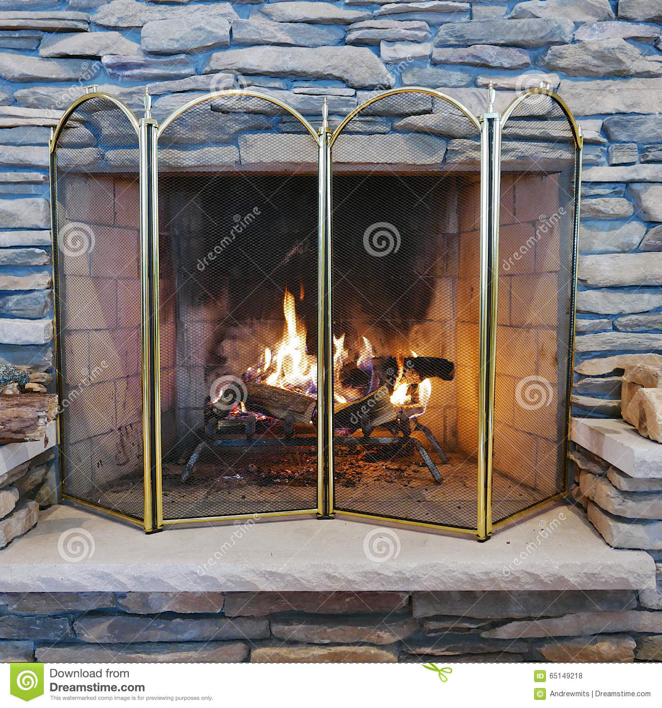 Indoor Wood Burning Stone Fireplace Stock Photo