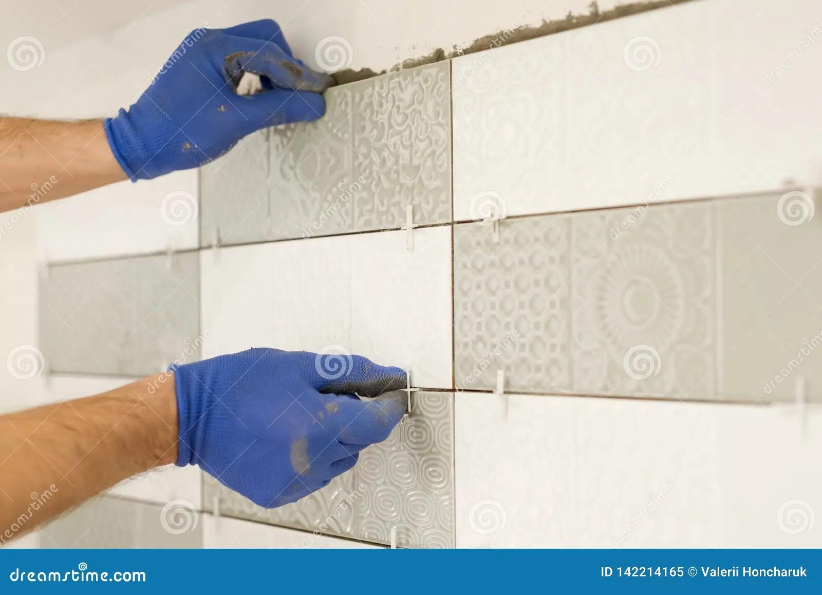 https www dreamstime com installing ceramic tiles wall kitchen placing tile spacers hands renovation repair construction image142214165