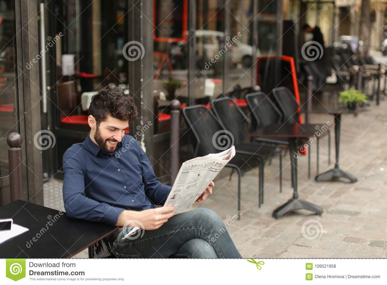Journalist With Close Up Face Reading Newspaper Article At