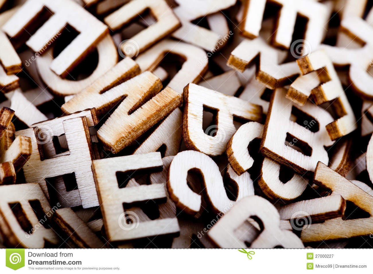 Jumbled Wooden Letters Close Up Stock Image