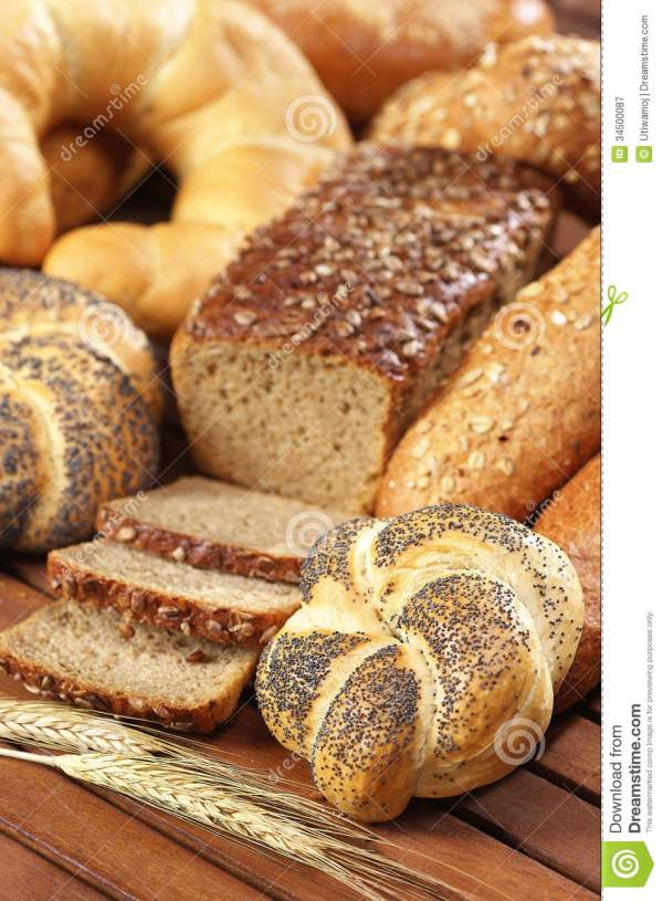 Kaiser Bread Roll With Poppy Seeds On Wooden Table Stock