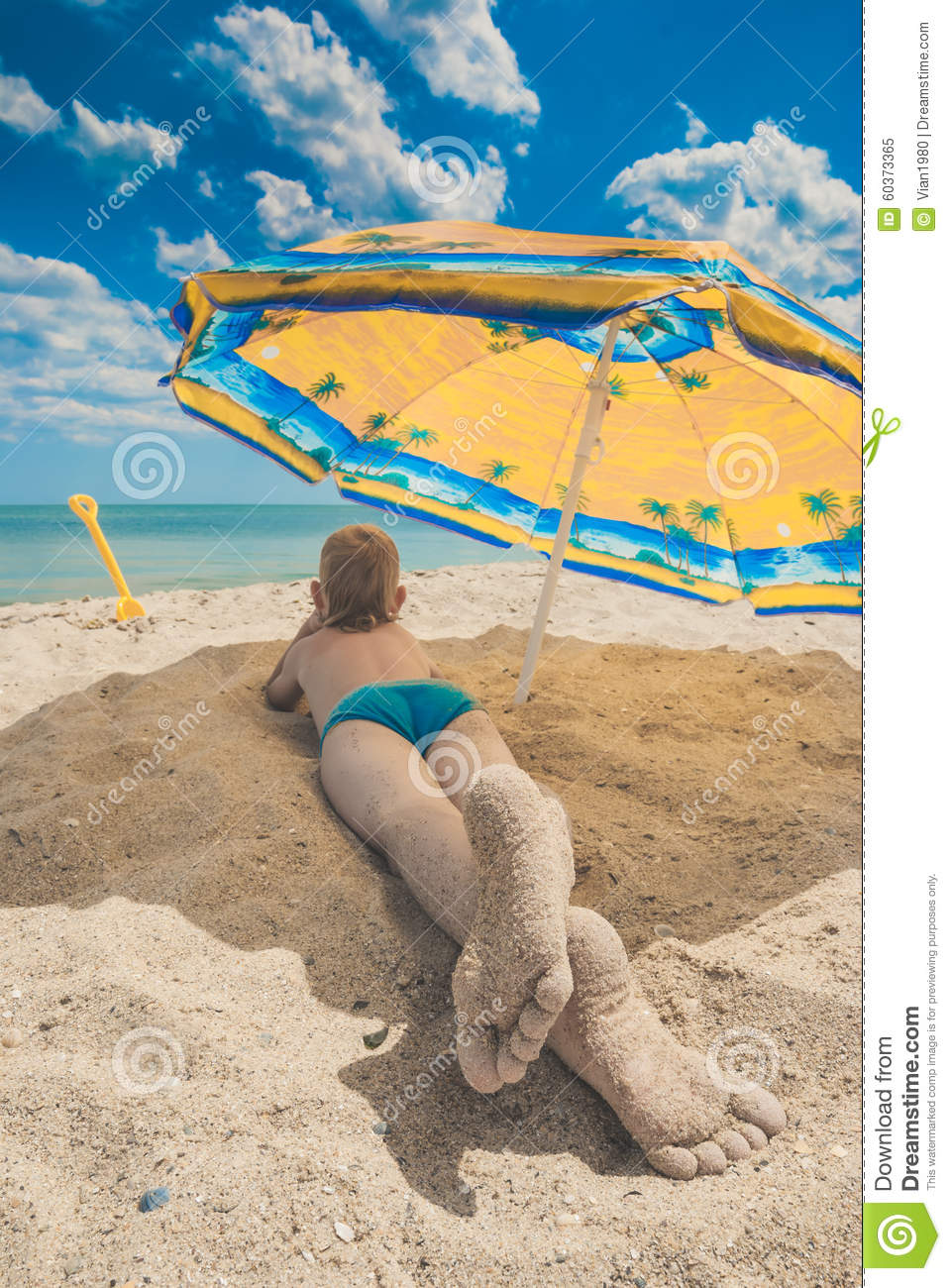 Kids feet in a send 2 stock image. Image of childhood ...