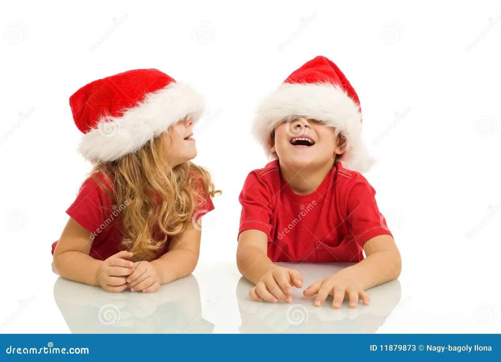 Kids Having Fun With Christmas Hats Stock Photos Image