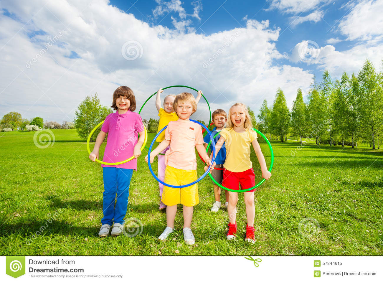 Kids Hold Hula Hoops During Exercising Activity Stock Image