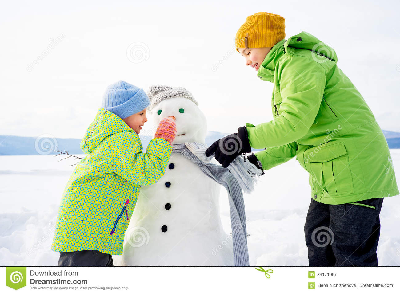 Kids Making A Snowman Stock Image Image Of Mother