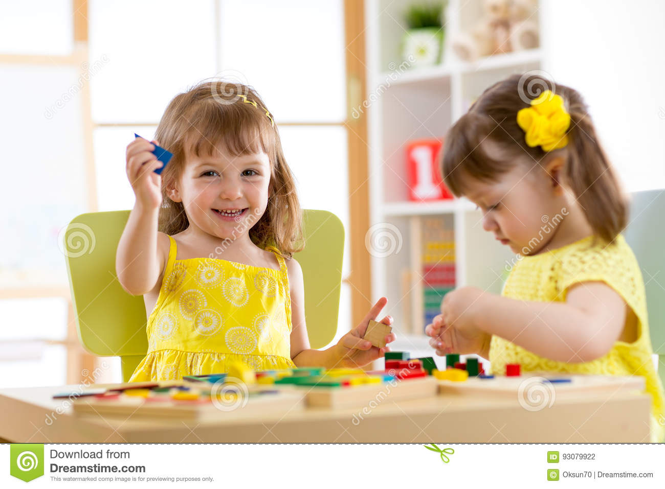 Kids Playing With Developmental Toys At Home Or